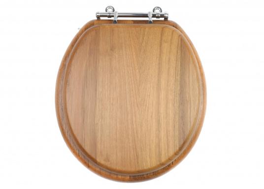 Dieser Toilettensitz aus Voll-Teak ist passend für fast alle runden Toiletten. Für ovale Toiletten können Sie die verchromten Vollmessingbeschläge einfach umdrehen bzw. anpassen.  (Bild 3 von 5)