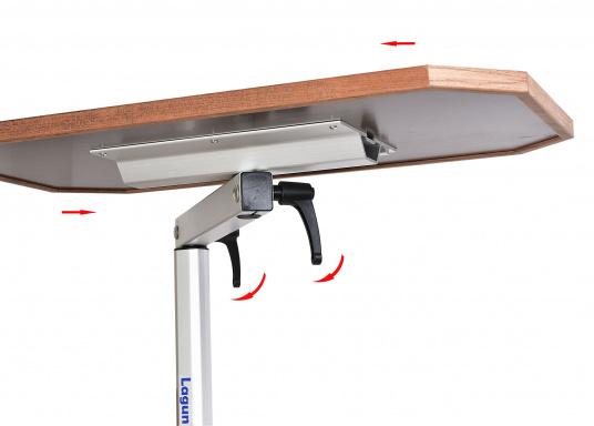 Eine praktische Lösung! Diese Konstruktion bietet variable Möglichkeiten: Der Tisch lässt sich heben und senken und ist dreh- und schwenkbar. Er ist platzsparend und leicht zu montieren. Erhältlich in verschiedenen Ausführungen.  (Bild 5 von 7)