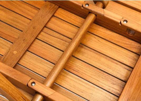Table pliante en teck, élégante et de belle facture. Facile àplier rapidement et fabriquée à partir de teck de haute qualité, elle résiste aux mauvaises conditions climatiques et aux fluctuations de température.  (Image 6 de 8)