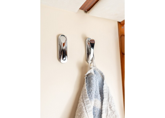 Elegant, space-saving wardrobe hooks in chrome-plated brass. They are spring-loaded and fold up when released.