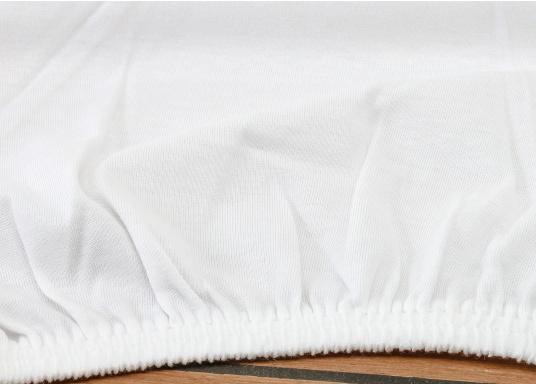 Hochwertiges, weißes Jersey-Spannbettlaken aus 100 % Baumwolle. Öko- Tex-Standard 100. Formstabil, bügelfrei und langlebig. (Bild 2 von 3)