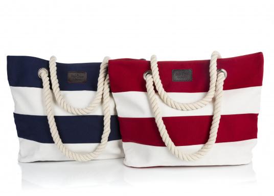 Strandtasche in maritimen Design. Geräumiges Hauptfach mit Druckknopfverschluss und kleinen Innenfächern für Portemonnaie und Handy. (Bild 4 von 4)