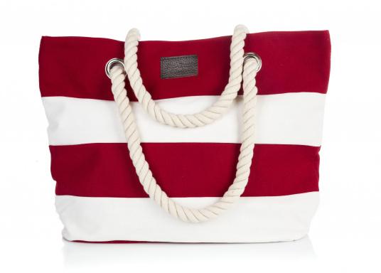 Strandtasche in maritimen Design. Geräumiges Hauptfach mit Druckknopfverschluss und kleinen Innenfächern für Portemonnaie und Handy.