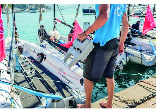 Man with outboard battery