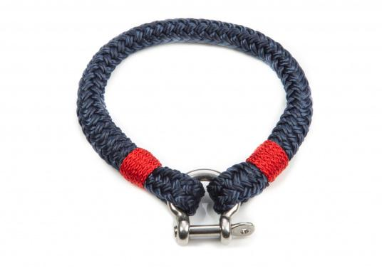 """The """"Sheet"""" wristband from Waterkant is made of sailing rope and is timelessly elegant, maritime jewellery. The single-coloured navy blue rope is decorated with red cord. The wristbands are handmade and braided. Make a statement!"""