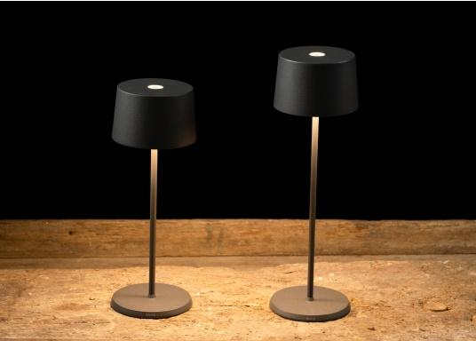 The high-quality OLIVIA LED table lamp has an integrated battery and stands out with its elegant design and high functionality. It suits any room and can be used both as a decorative lamp and as table lighting, creating a cosy atmosphere. (Image 3 of 9)